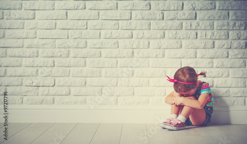 little child girl crying and sad about brick wall Canvas Print