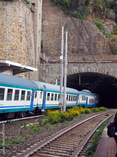 Photo  commuter train railroad  station built through mountain Cinque T