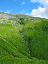 Waterfall On The Way To Ben Nevis Mountain In Scotland