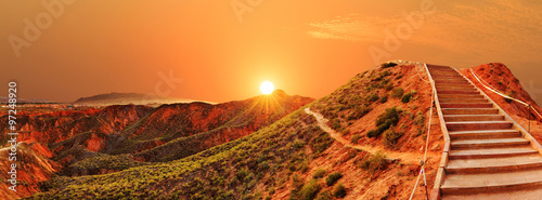 Stickers pour porte Orange eclat sunrise,sunset skyline, paved step road and landscape of red san