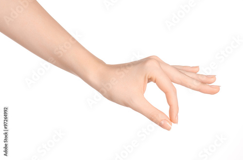 Beauty and Health theme: beautiful elegant female hand show gesture on an isolat Poster Mural XXL