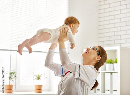 Fotografering  doctor examining a baby
