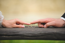 Couple Touching Rings