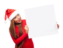 Portrait Of A Beautiful Young Woman At Christmas Holding A White Banner