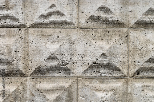 Old ashlar wall made of dolomite rock carved in geometrical pattern Wallpaper Mural