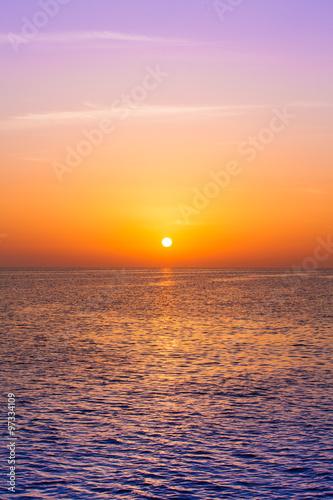 Beautiful sunset above the sea.  Scenic view of beautiful sunset - 97334109