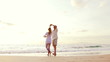 Mature Retired Couple in Love on Tropical Vacation. Kissing at the Beach.