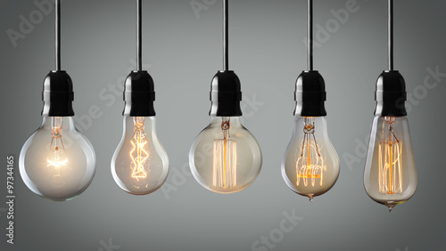 Photo  Vintage hanging light bulbs over gray background