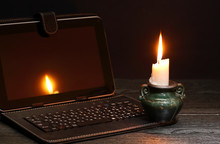 Candle Near Laptop