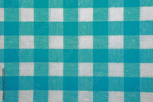 The texture of checkered fabric as a background. Wallpaper Mural