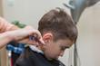 boy at barber , haircut