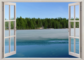 Open window view to lake with ice