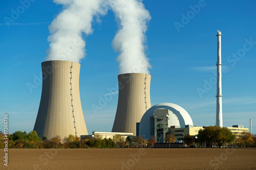 Nuclear power plant on the sky background