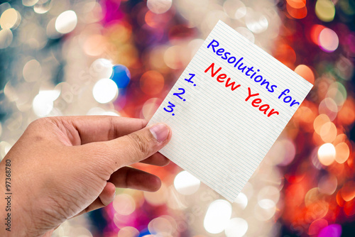 Fotografía  New Year's  Resolution handwriting on a sticky note