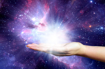 open female hand holding a powerful light - Elements of this image furnished by NASA