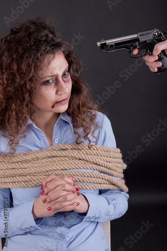 terrorists threatening the a frightened girl with gun Canvas Print