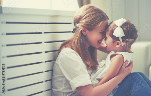 Fotografie, Obraz  Happy loving family. mother and child playing,  kissing and hugg