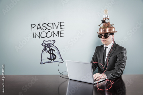 Fotografía  Passive income concept with vintage businessman and laptop
