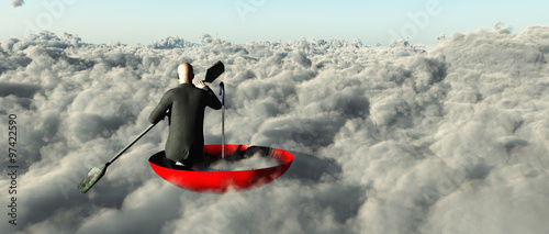 Photo Man paddling through clouds in an upturned umbrella