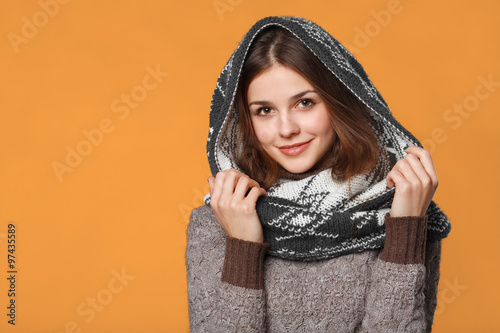 80e160a99ab3 Christmas girl wearing knitted wear scarf. Young beautiful smiling girl,  winter concept, isolated