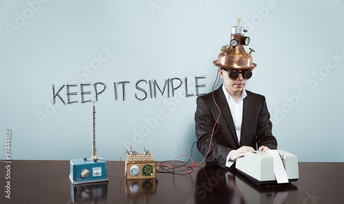 Fotografie, Obraz  Keep it simple concept with vintage businessman and calculator