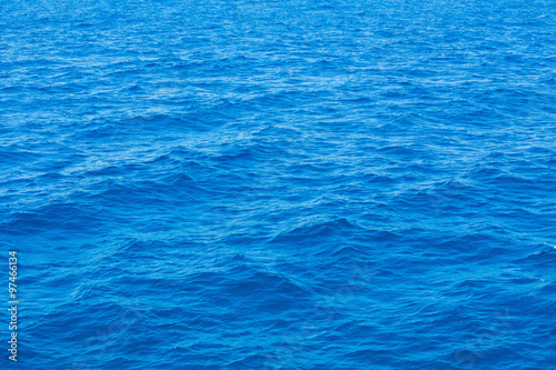 Wall Murals Ocean Blue sea surface with waves