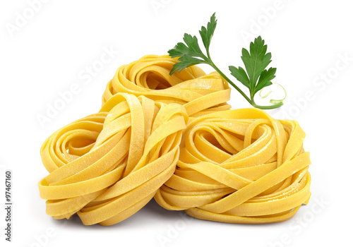 Cuadros en Lienzo  Italian rolled fresh fettuccine pasta with flour and parsley isolated on white background