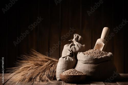 Fototapeta Grain of the wheat in bags obraz