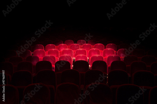 Fotografie, Tablou Lights on red seats in a theater