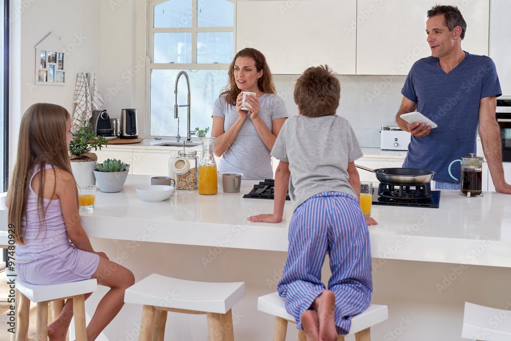 Fototapeta family in kitchen for breakfast - obraz na płótnie