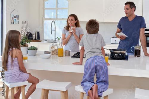 Fototapeta family in kitchen for breakfast obraz na płótnie