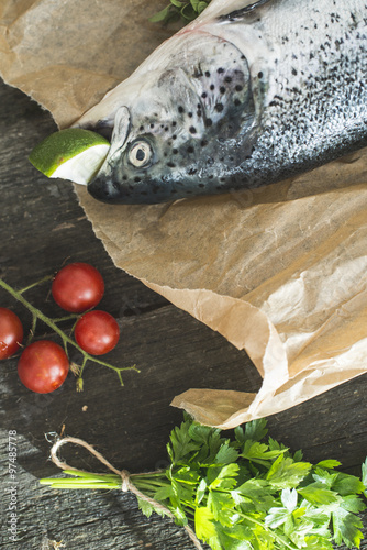 Preparing whole salmon fish for cooking Wallpaper Mural