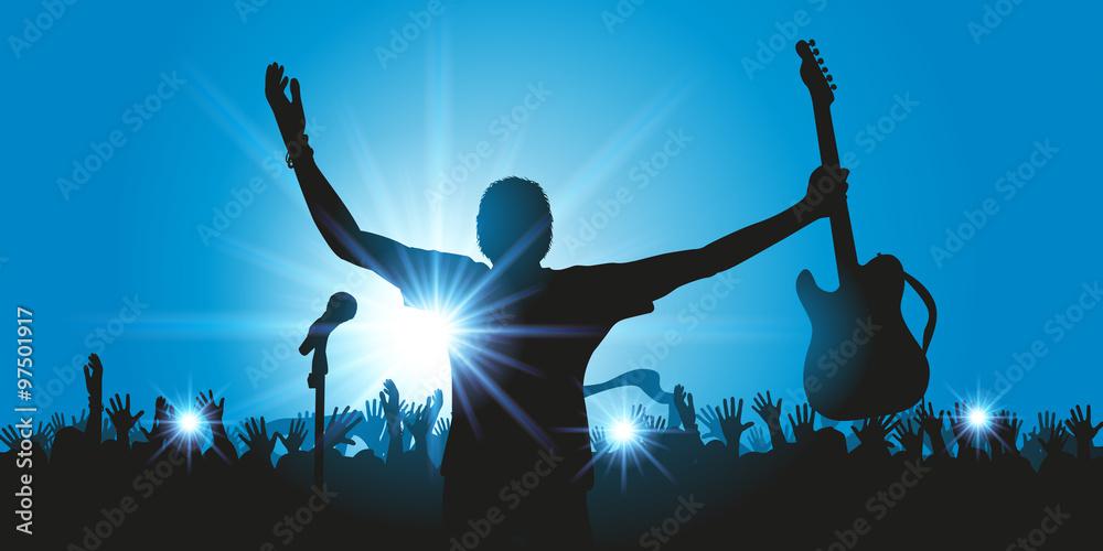 Fototapety, obrazy: Concept du concert de musique rock avec un chanteur qui salue son public en brandissant sa guitare et la foule qui l'applaudit à la fin du spectacle.