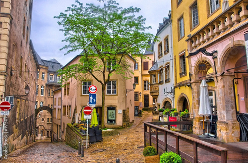 Photo Stands Narrow alley LUXEMBOURG CITY - JUN 2013: Narrow medieval street w