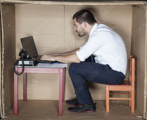 businessman in small office working on laptop
