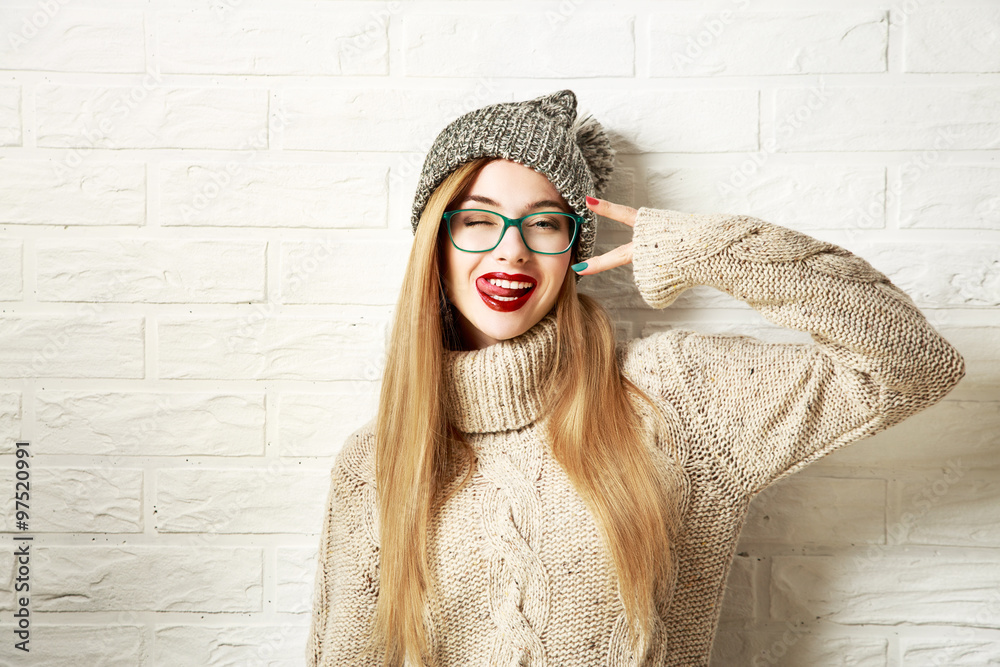 Fototapeta Funny Hipster Girl in Winter Clothes Going Crazy