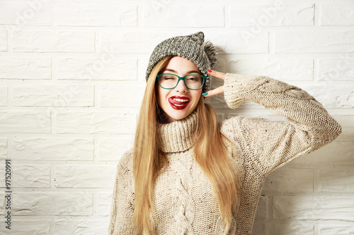Funny Hipster Girl in Winter Clothes Going Crazy Slika na platnu