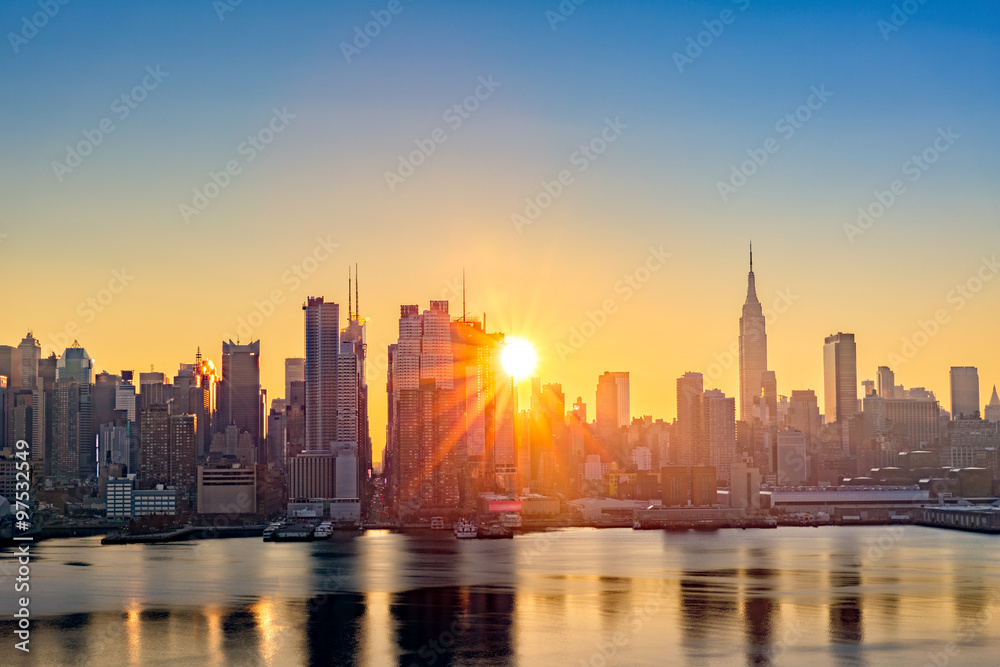 Fototapety, obrazy: Midtown Manhattan skyline at sunrise, as viewed from Weehawken, along the 42nd street canyon