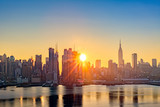 Fototapeta Nowy Jork - Midtown Manhattan skyline at sunrise, as viewed from Weehawken, along the 42nd street canyon