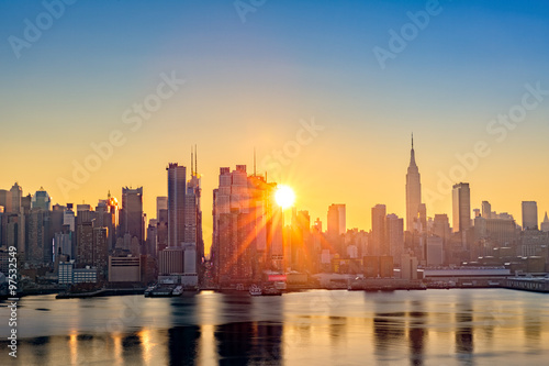 Poster New York Midtown Manhattan skyline at sunrise, as viewed from Weehawken, along the 42nd street canyon