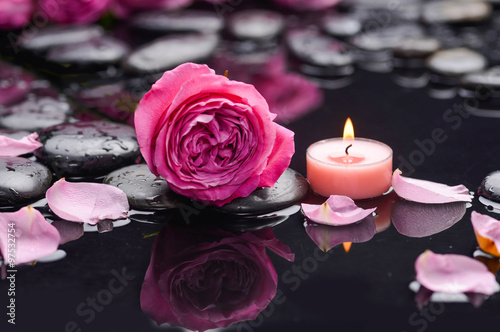 Foto op Canvas Spa rose petals with candle and therapy stones
