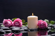 Three rose with candle and therapy stones