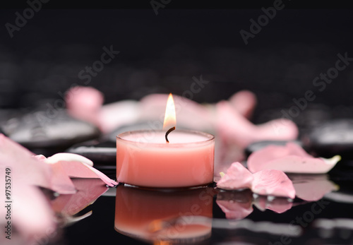 Staande foto Spa Beautiful rose petals with candle and therapy stones