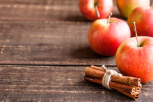 Fresh Apples And Cinnamon On A Wooden Table