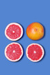 Leinwanddruck Bild - Minimal Design. Fresh Grapefruit on a blue background