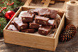 Christmas fudge traditional homemade chocolate sweet dessert food in wooden box on vintage table background