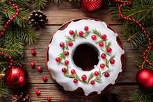 Traditional Homemade Christmas Cake Holiday Dessert With Cranberry In New Year Tree Decorations Frame On Vintage Wooden Table Background. Rustic Style