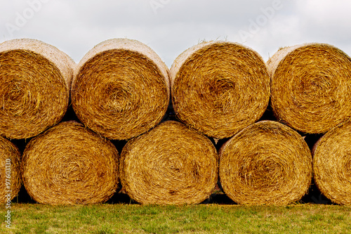 Valokuva  Hay bales on the field after harvest. A stack of hay.