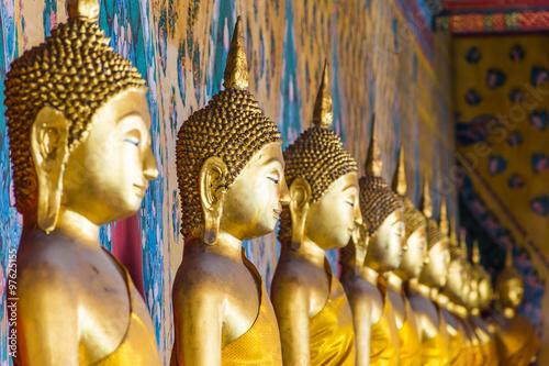 Tuinposter Boeddha Row of Buddha statues