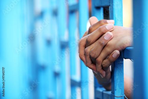 hand in jail Wallpaper Mural